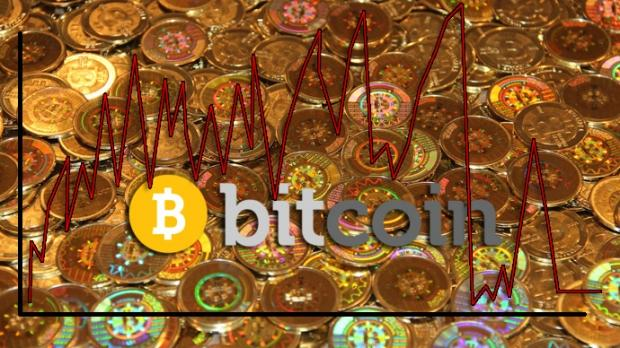 bitcoin_exchange_mt_gox_suspends_trading_admits_massive_fluctuations_in_price